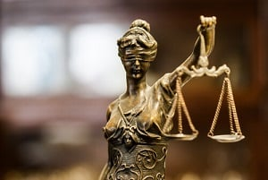 statue of blind justice presiding over wrongful death case